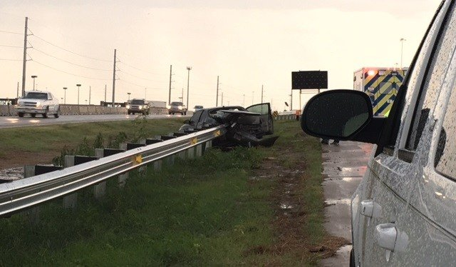 Rollover crash on SB I-235 near Central during a severe thunderstorm.