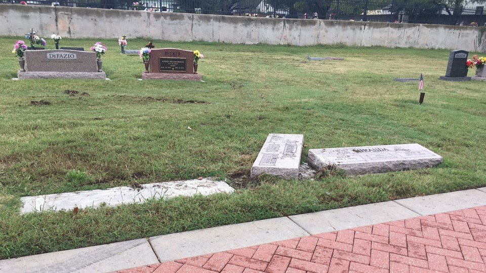 Damage to headstones at Calvary Cemetery caused by a driver in a stolen vehicle.