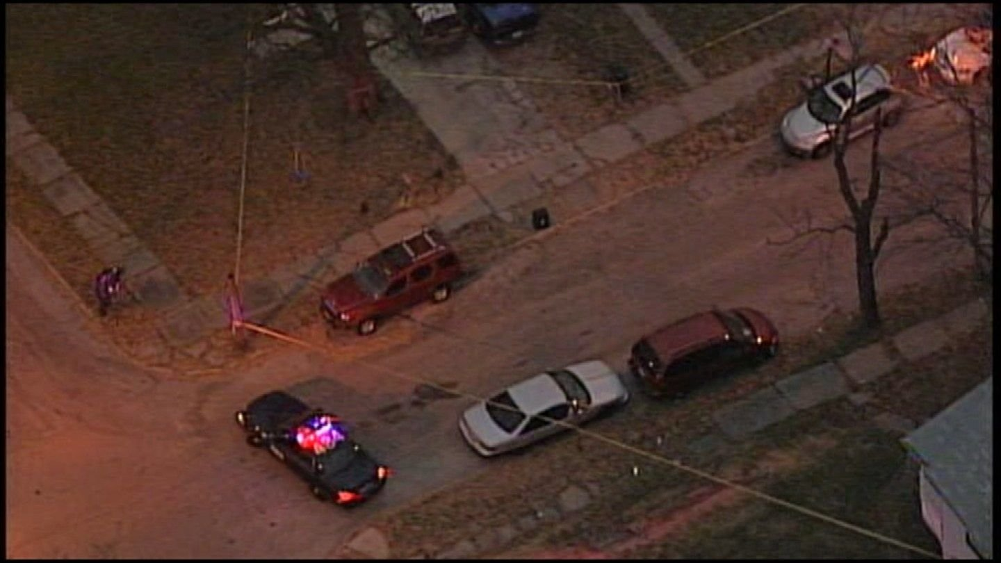 The body was found at a home in the 2400 block of College Avenue. (KCTV)