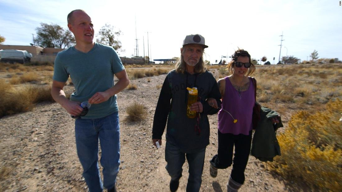 Holets walks with Hope's birth parents, Tom Key and Crystal Champ.