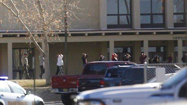 (Jon Austria /The Daily Times via AP). Students are led out of Aztec High School after a shooting Thursday, Dec. 7, 2017, in Aztec, N.M. The school is in the Four Corners region and is near the Navajo Nation.