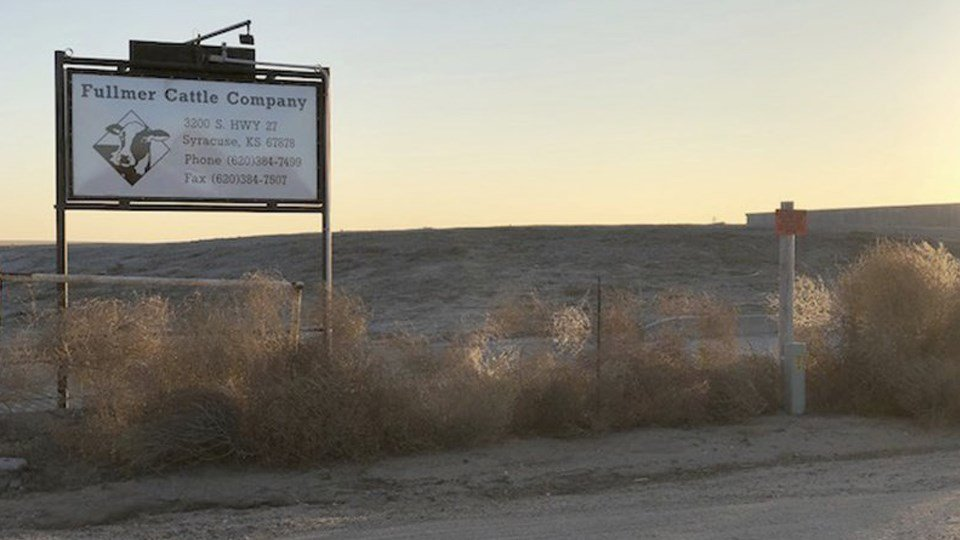 (AP) Dec. 11, 2017 photo, shows a sign outside the Fullmer Cattle Co. in Syracuse, Kan. Several former workers say the western Kansas calf ranch forces immigrants to toil long days to work off loans from Fullmer Cattle Co. for the cost of smuggling them.