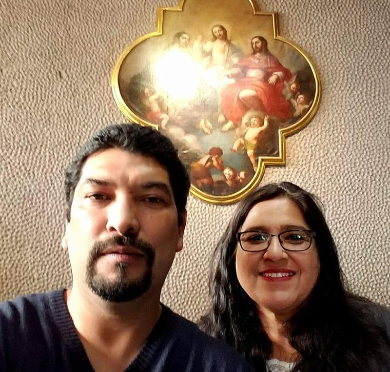 (AP) Dec. 2017, photo provided by Rachel Tovar, right, poses with her husband Arturo Tovar at a Catholic cathedral in Mexico City.