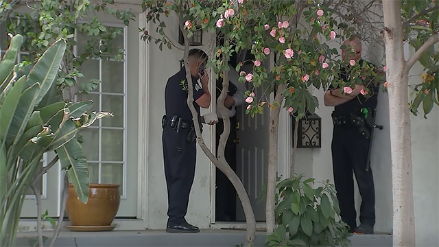 Los Angeles police arrive at the home where a 4-month-old baby was mauled to death by her family's dog on Saturday, May 5, 2018. (Source: KABC via CNN)