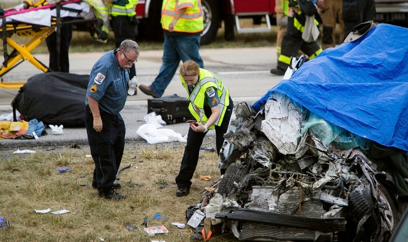 Paramedics work the scene of a deadly car crash on Route 1 near Townsend, Del., Friday, July 6, 2018. (Suchat Pederson /The News Journal via AP)