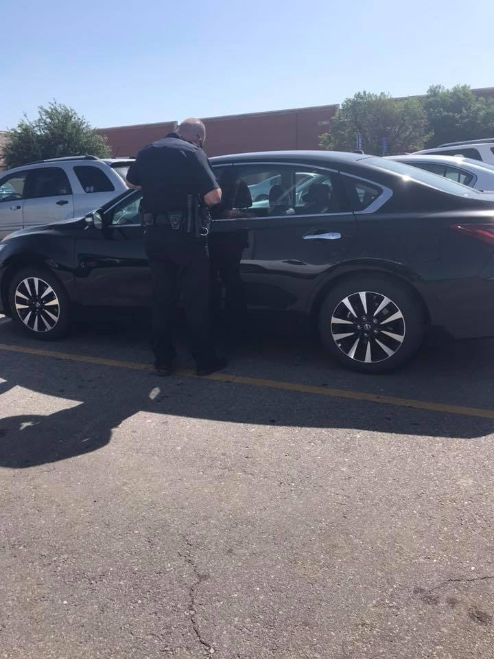Officer breaks window to rescue dog in hot car