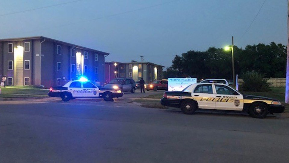 Officers block off entrances to an apartment complex in southeast Wichita