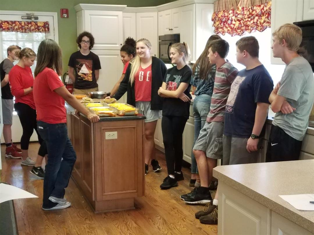 Maize High students prepare a meal for residents at the Sleepy Hollows Ronald McDonald House.