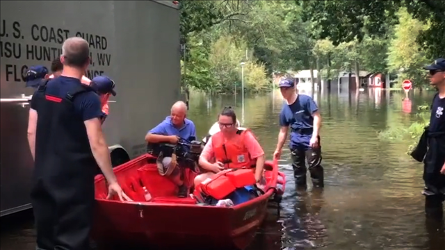 Coast Guard rescues a family from floods in North Carolina, Photo Date: 9/17/2018