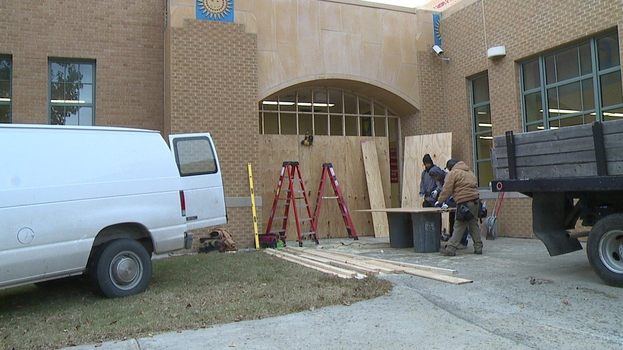 North High School's gym doors were damaged when suspects backed a stolen van into the building on Nov. 6, 2018. (KAKE)