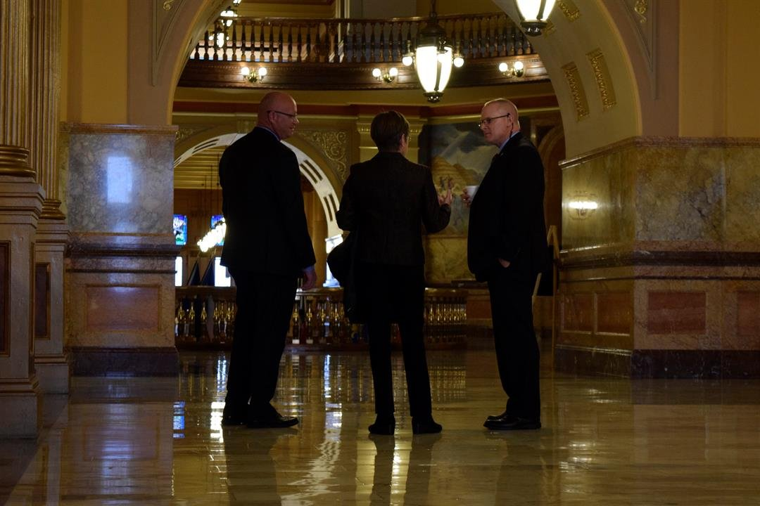 Laura Kelly speaking with her security detail after her first news conference as Governor-elect of Kansas.