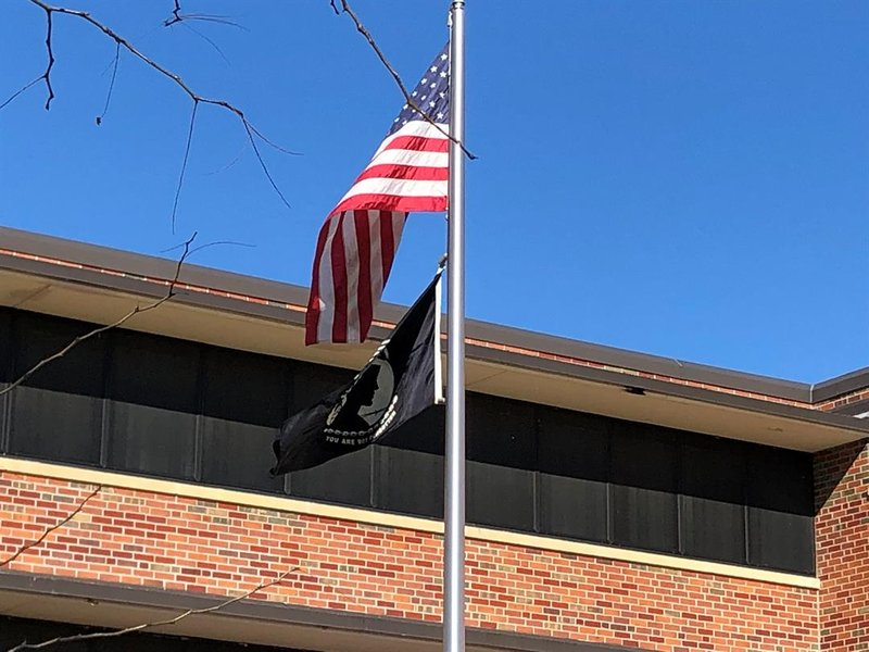 The U.S. and MIA/POW flag fly over the Wichita State campus Wednesday.