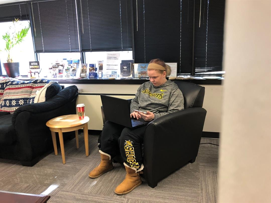 A student veteran studies in the lounge at Wichita State's Military and Veterans Services office.