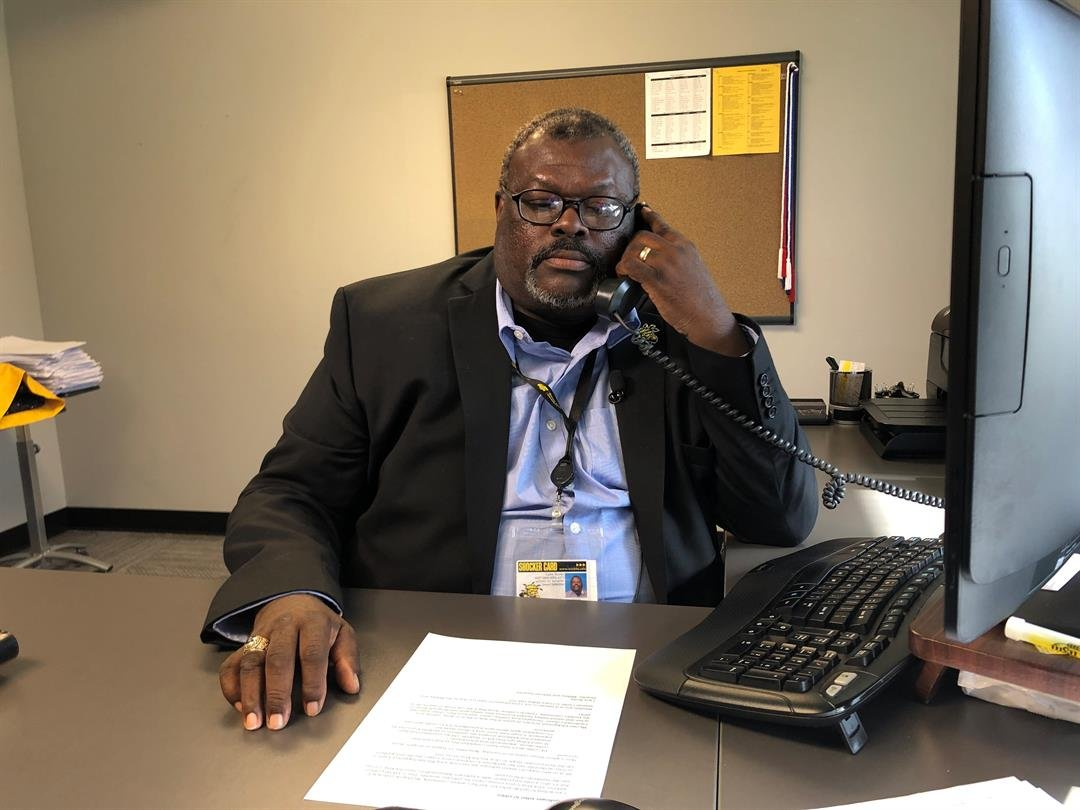 Lt. Col. Larry Burks, Sr, (Ret. Army) answers a student's questions over the phone Wednesday at WSU's Military and Veteran Services office.
