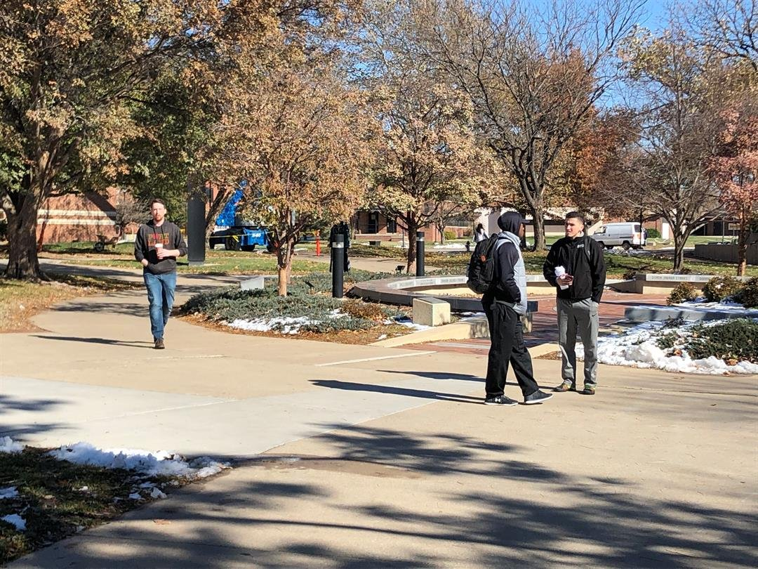 Students cross central campus at Wichita State Wednesday afternoon.