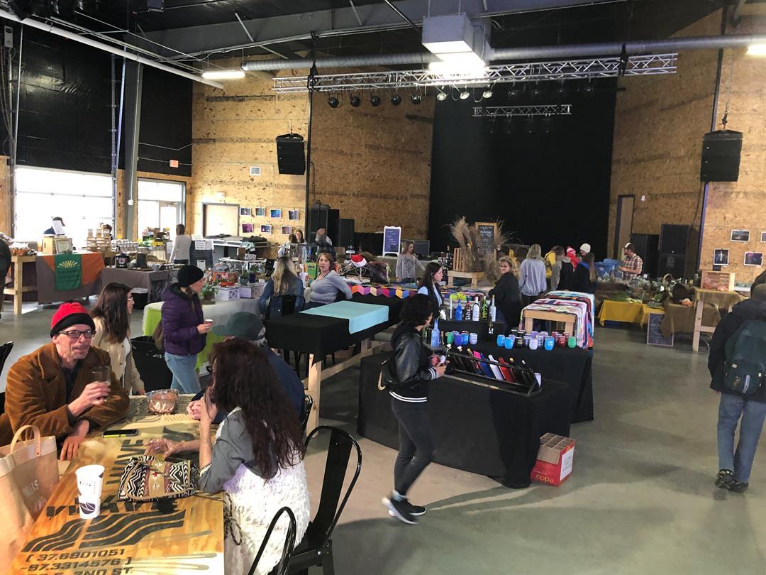 Hundreds pass through Wichita's Old Town Farmers' Market Sunday.