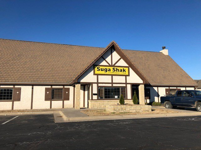 Signs appear annoucning the Suga Shak Gentlemen's Club in east Wichita