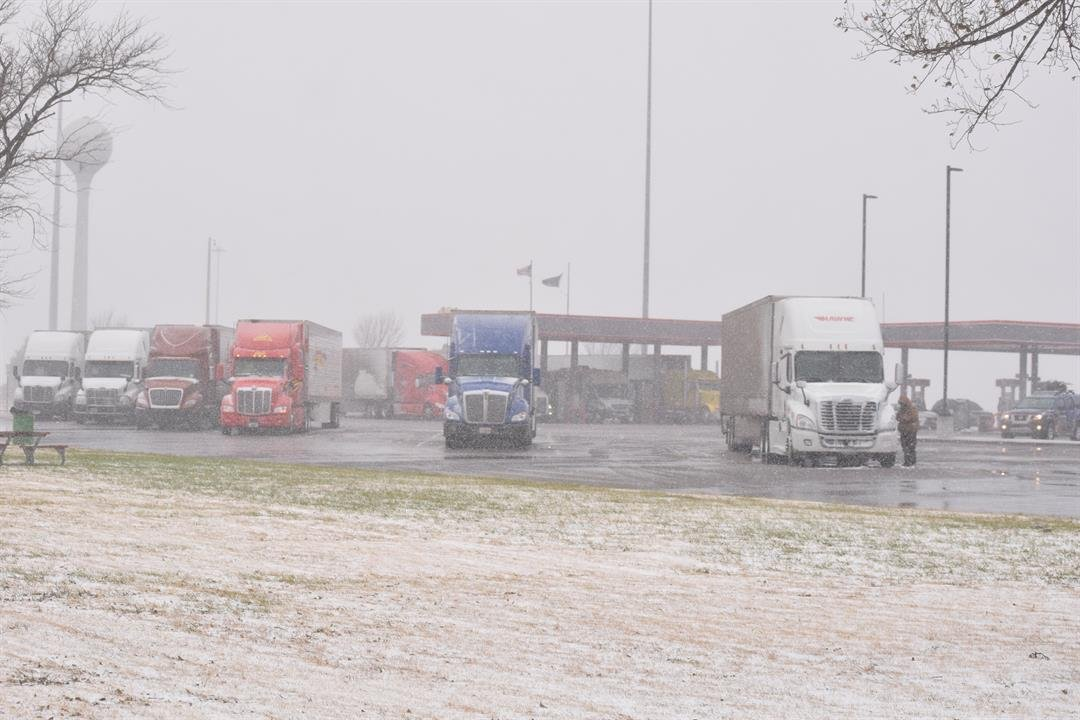 A busy day at the Towanda rest area along the Kansas Turnpike Sunday as truckers and holiday travelers seek shelter from the winter storm.