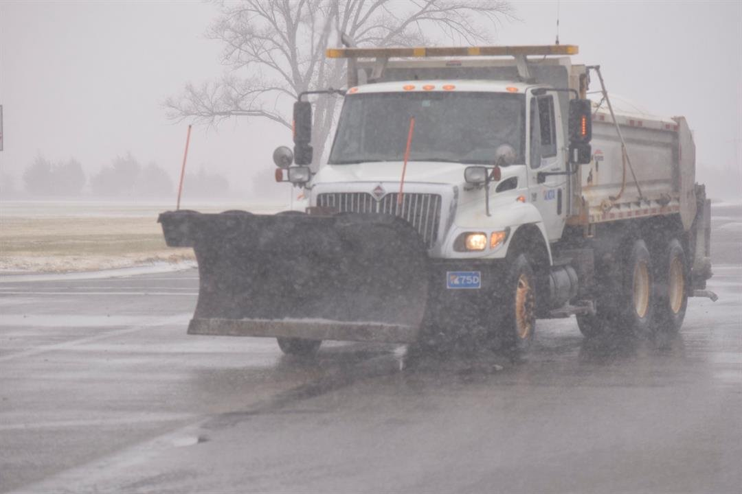 Road crews gave up part of their Thanksgiving holiday to help keep Kansas highways cleared Sunday,.