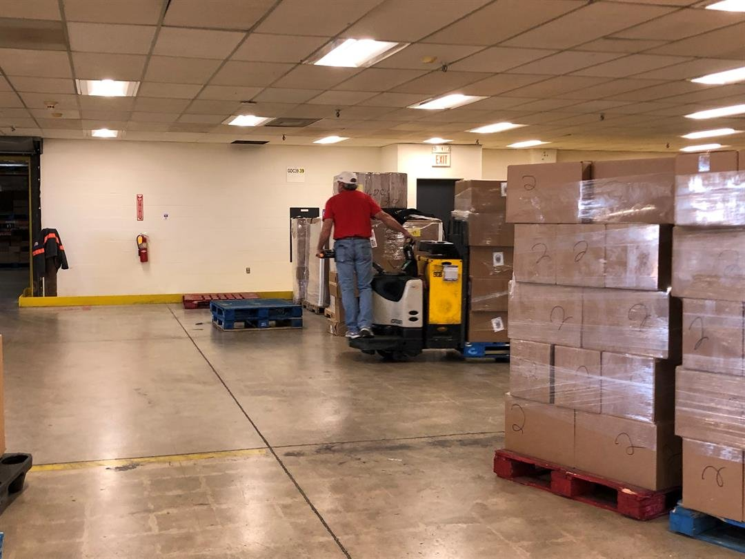 Loading pallets full of Christmas food boxes onto trucks for delivery in Sedgwick and Harvey Counties Wednesday, December 12, 2018.