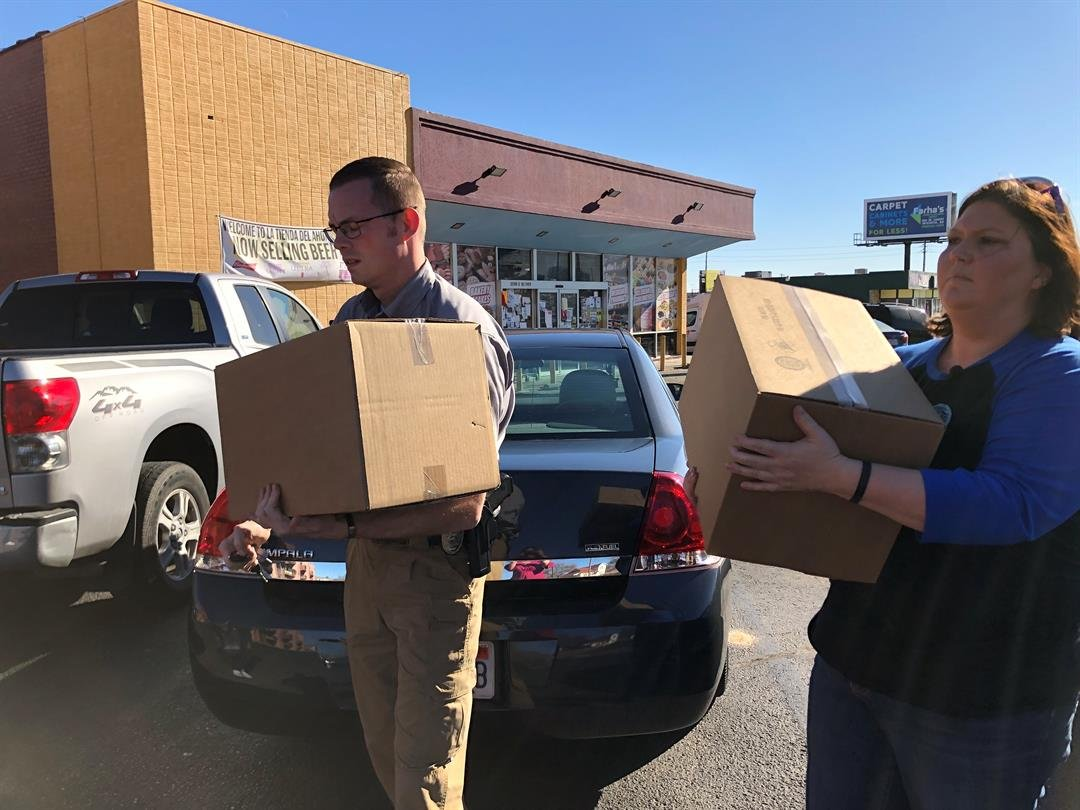 Deputies Aaron Miller and Jaime Kleman delivering boxes to the man they say give the biggest donation to the Kunze family after Deputy Robert Kunze died in the line of duty in September.  His donation totaled $4.76.