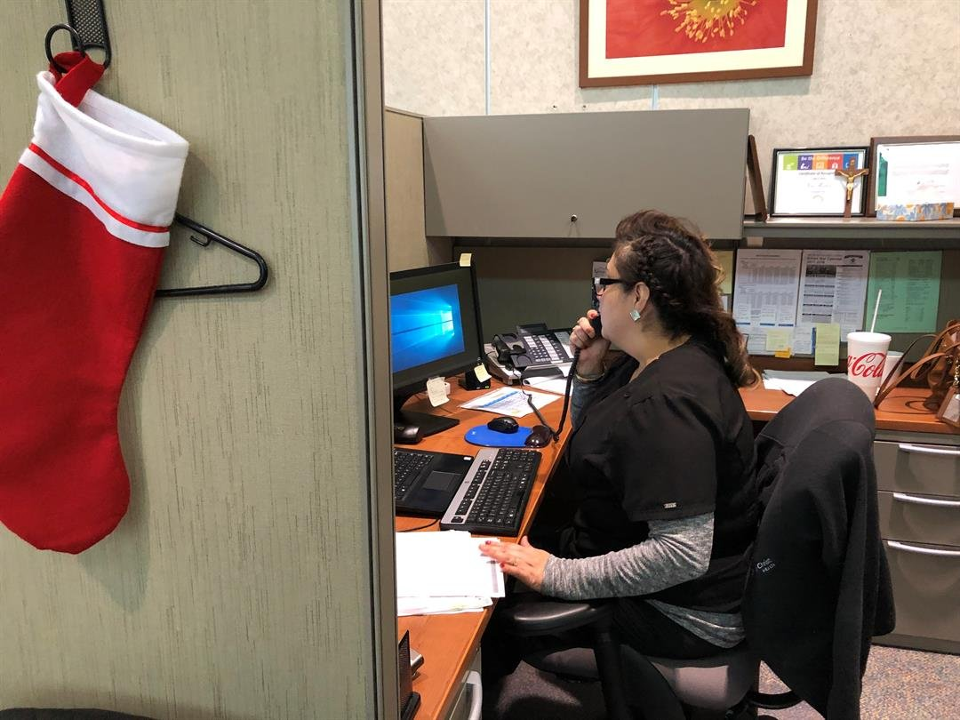 A Via Christi ACA Healthcare Navigator helps a Kansan by phone to enroll in the Healthcare Marketplace Exchange.
