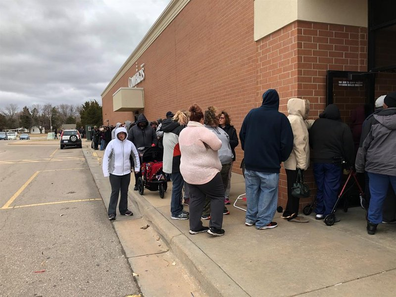 Hundreds lined up to get a holiday food box and other goodies as Operation Holiday began its annual distribution on Thursday.