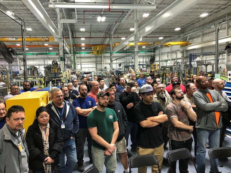 Hundreds of workers gathered around to hear the announcement on one of Spirit's factory floors.