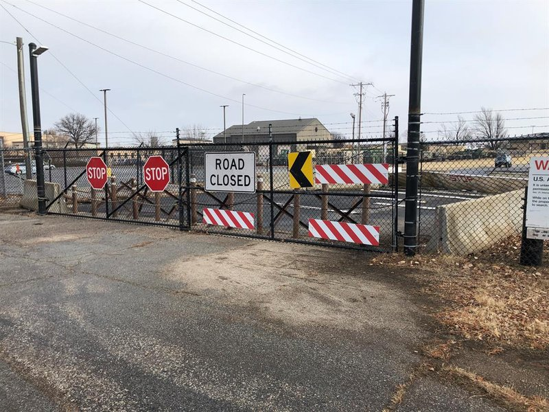 By dawn, Monday, December 31st, 2018, crews had repaired the damage a fiery crash the night before did to this little used back entrance to McConnell Air Force Base.