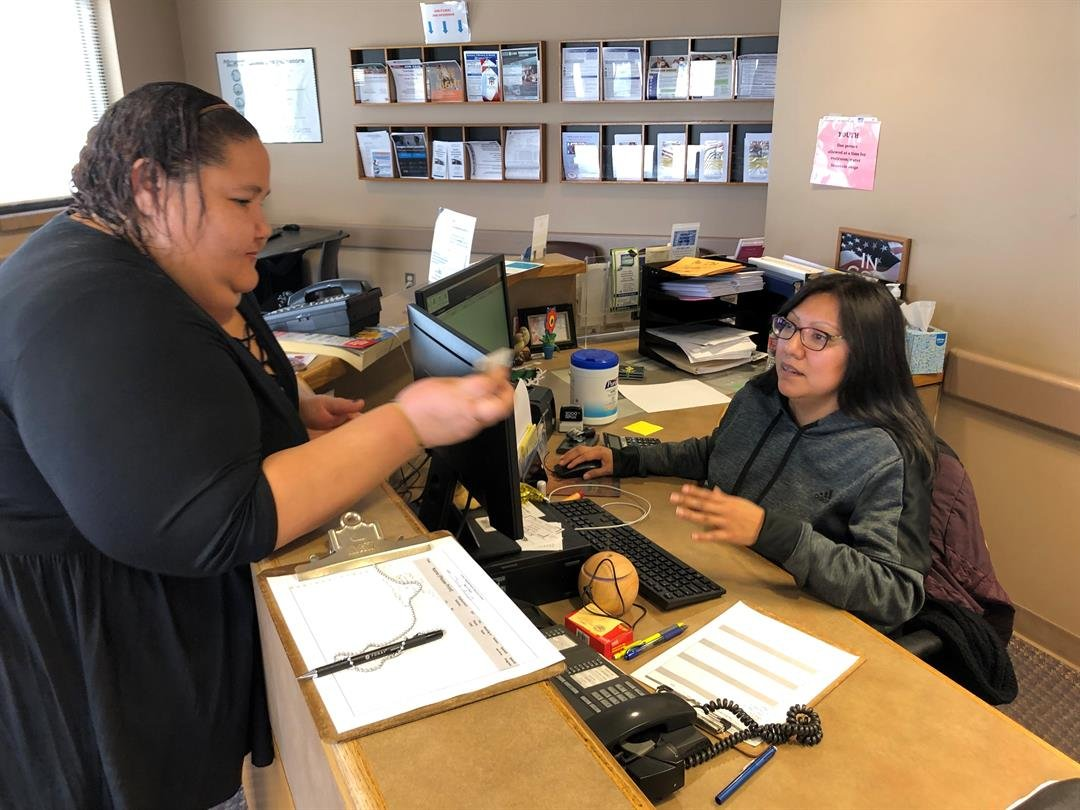 Danielle Steiner checks out the first free hotspot from the City of Wichita at Colvin Neighborhood Resource Center on Thursday, February 7th, 2019.