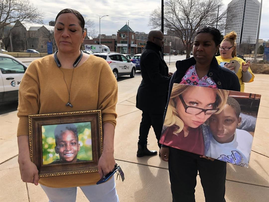 Roy'ale Spencer was 9 years old when he died on January 21st, 2019.  Here, two family members hold pictures of him at a demonstration on Thursday, February 14, 2019.