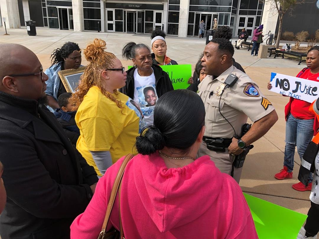Roy'ale Sopencer's mother, Geneva Smith, speaks with the head of courthouse security about where the demonstrators are allowed to stand on Thursday, February 14, 2019.