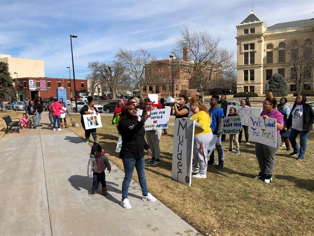 After about an hour, the demonstrators moved over to the grassy area in front of the wing where the district attorney's office is housed.  They shouted for Marc Bennett to release more information about Roy'ale's death.