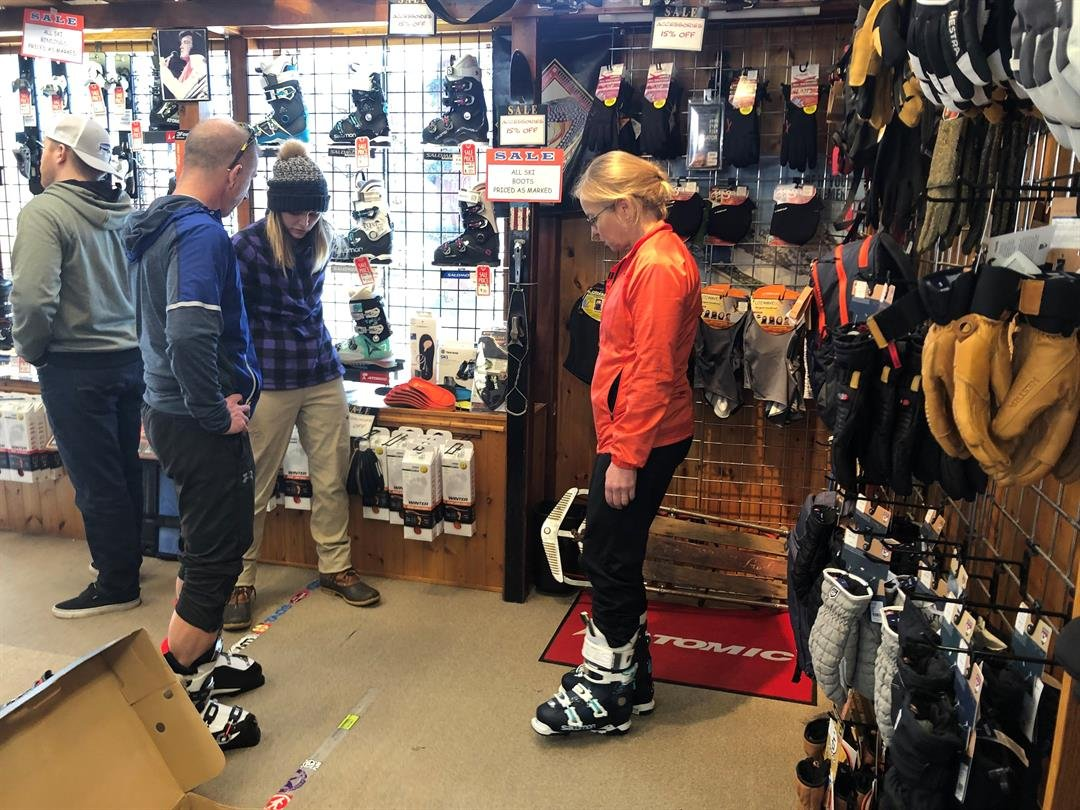 Winter themed stores like The Slope are making a profit off this winter's cold, snowy weather.  Sunday, March 3, 2019, Sandy Begnoche stopped by for lift tickets and found herself trying on ski boots, too.