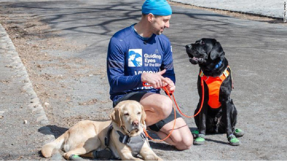 Thomas Panek with his guide dogs Westley and Waffle