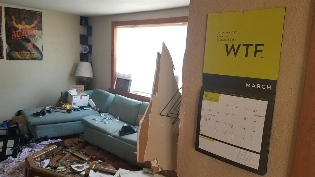 Three days after a car crashed into their South Wichita living room, Tiffany and Zechariah Ellis are left with a mess that includes gasoline and oil still soaking into their floor on Sunday, March 17, 2019.
