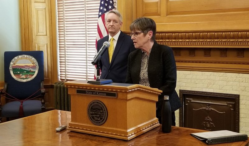 Governor Laura Kelly speaking with Judge Jeffry Jack. (Photo by Stephen Koranda)