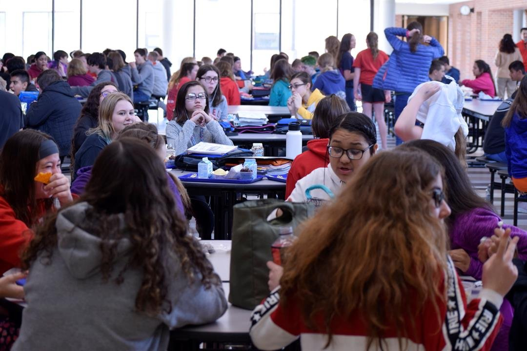 Middle school students eat lunch in a crowded cafeteria at Maize Middle School on Tuesday, March 19, 2019.  The district says this school will be full next year at the current pace of growth.