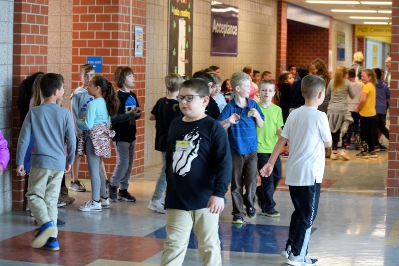Students crowd the hallway at Maize South Elementary on Tuesday, March 19, 2019, as they return to classes after lunch recess.  The district says it will need three more classrooms in this school next year.