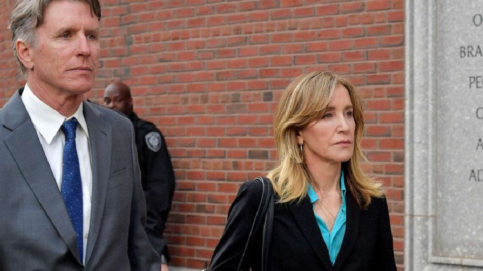 (Paul Marotta/Getty Images)  Felicity Huffman exits the John Joseph Moakley U.S. Courthouse after appearing in Federal Court to answer charges stemming from college admissions scandal, April 3, 2019,in Boston.