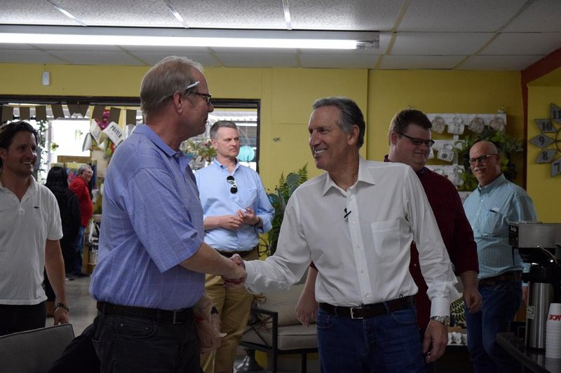 Former Starbucks CEO and potential independent presidential candidate Howard Schultz shakes hands as he arrives at a listening tour stop in McPherson on Wednesday afternoon, April 10, 2019.