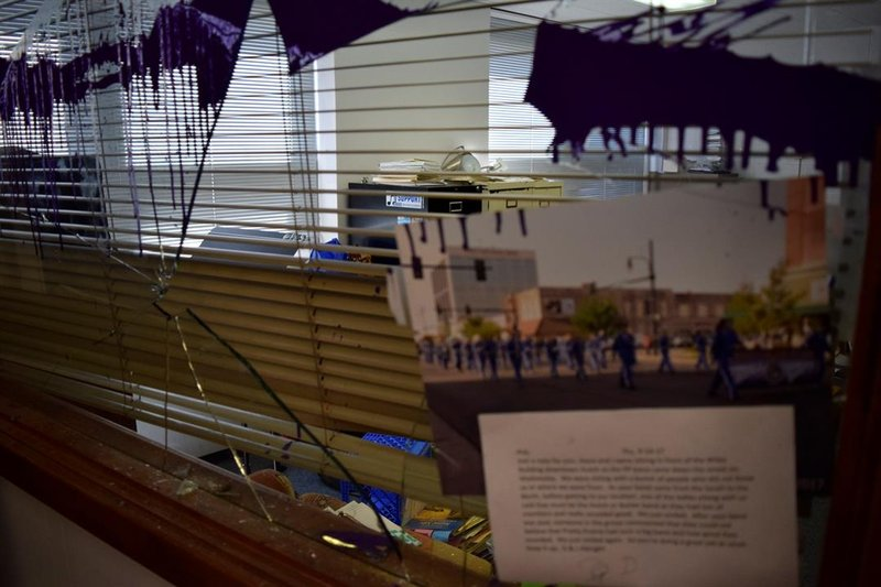 Also broken through, the window separating Koch's office space from the general music room.  The window and possibly a doorframe will have to be replaced.  In the foreground, a photo of the high school marching band performing in a parade.