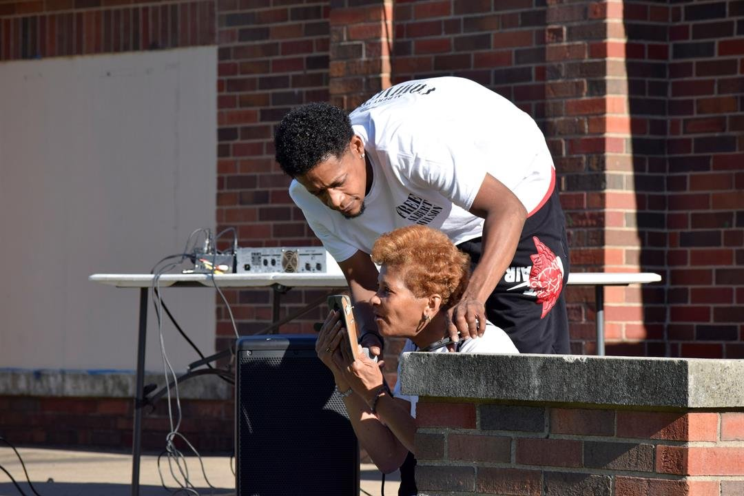 Wilson's mother and brother speak to him via phone after he spoke briefly to the crowd Sunday evening.