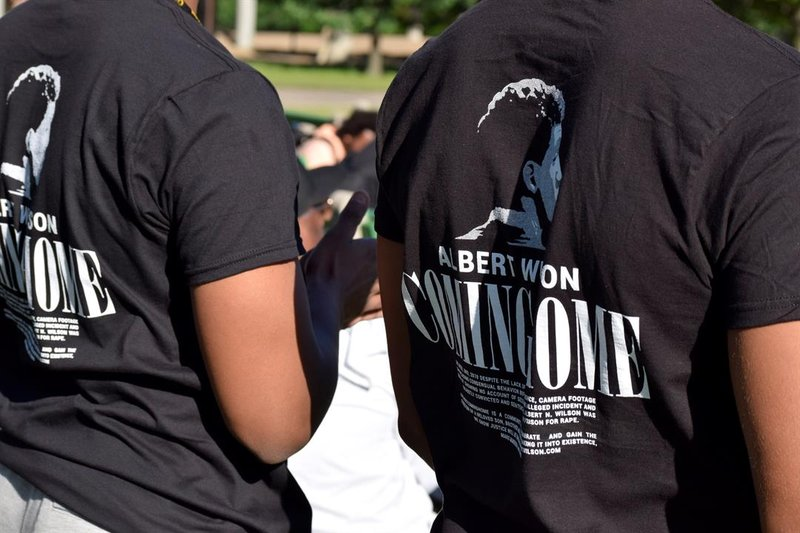 """""""Albert Wilson Coming Home"""" read the t-shirts many were wearing.  His family and friends are selling the t-shirts to raise money for his legal fees."""