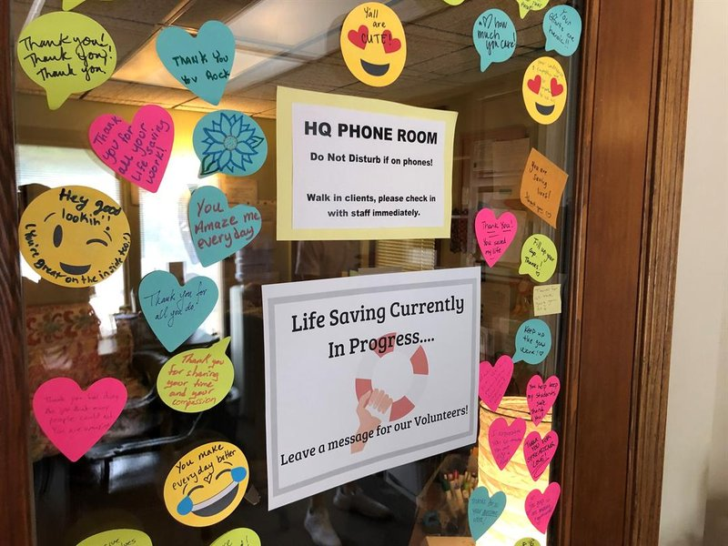 The door to the current National Suicide Prevention Hotline call center in Lawrence, Kansas.  Taking calls from Kansans is tough, so Monica Kurz says they decorate the door with motivational phrases and encouragement.