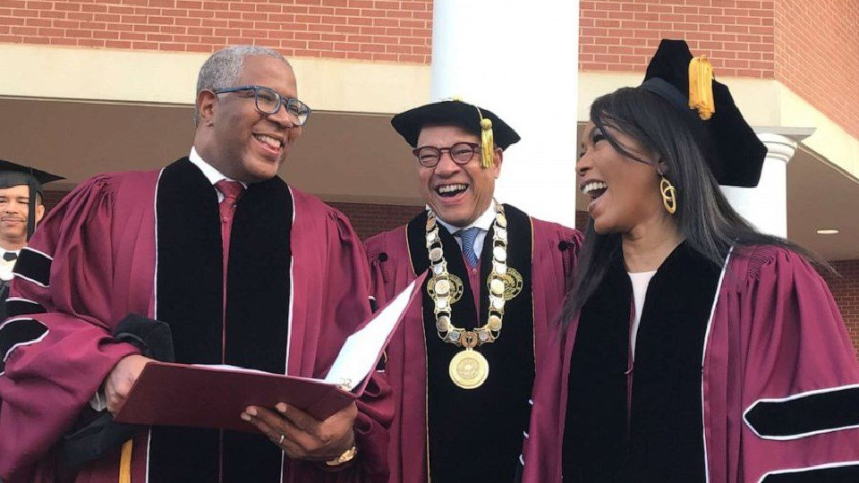 Robert F. Smith, left, laughs with David Thomas, center, and actress Angela Bassett (Bo Emerson/Atlanta Journal-Constitution via AP)
