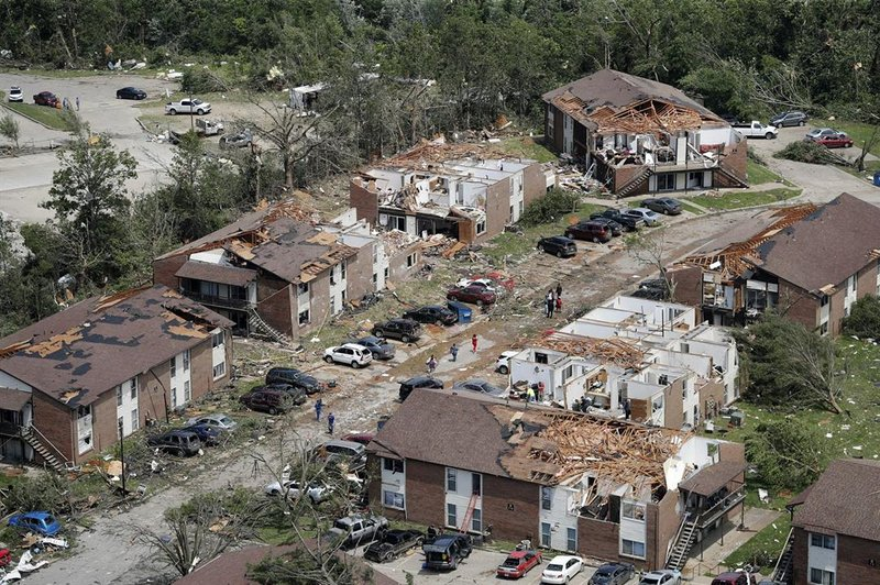 A tornado tore apart buildings in Missouri's capital city as part of an overnight outbreak of severe weather across the state. (AP Photo/Jeff Roberson)