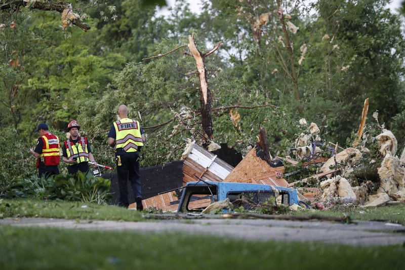 Storm damage liters a residential neighborhood, Tuesday, May 28, 2019, in Vandalia, Ohio. A rapid-fire line of apparent tornadoes tore across Indiana and Ohio overnight, packed so closely together that one crossed the path carved by another. (AP Photo)