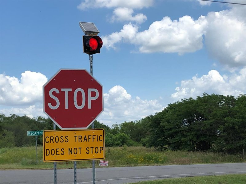 Sedgwick County plans to add solar powered flashing beacons like this one to the stop signs on 183rd at MacArthur.