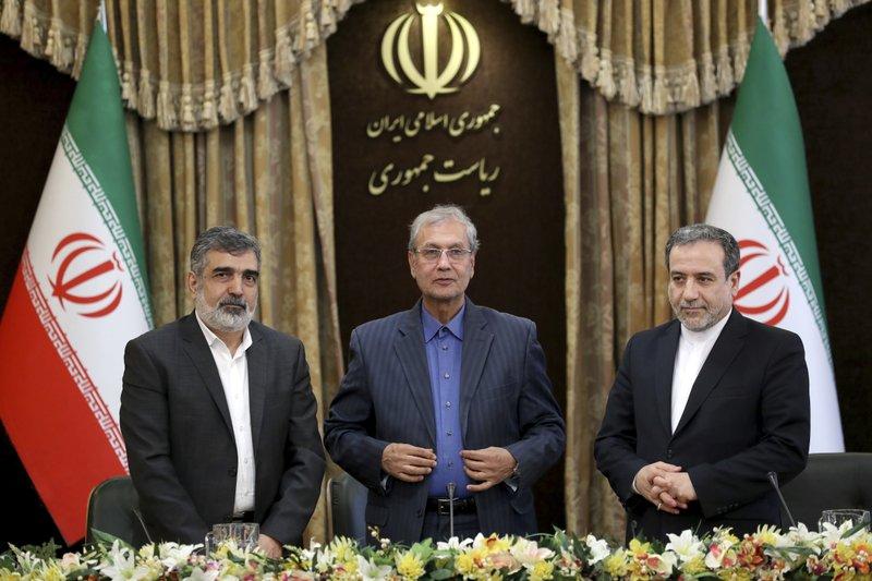 From left to right, spokesman for Iran's atomic agency Behrouz Kamalvandi, Iran's government spokesman Ali Rabiei and Iranian Deputy Foreign Minister Abbas Araghchi. (AP Photo/Ebrahim Noroozi)